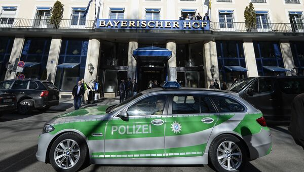 A police car passes the Bayerischer Hof hotel in Munich, southern Germany, on February 16, 2017. The Bayerischer Hof hotel will be the location for the 53rd Munich Security Conference (MSC) from February 17-19, 2017. - Sputnik International