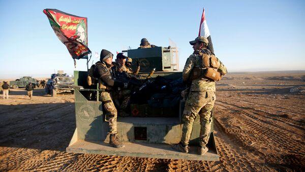 Iraqi security forces advance towards the western side of Mosul, Iraq February 19, 2017. - Sputnik International