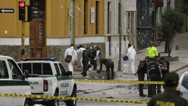 Police and investigators inspect the site where a homemade bomb exploded near the Santamaria bull ring in Bogota, Colombia - Sputnik International