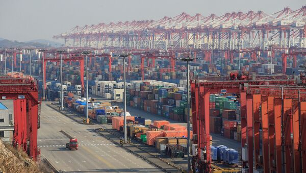 Containers are seen at the Yangshan Deep Water Port, part of the Shanghai Free Trade Zone, in Shanghai, China, February 13, 2017 - Sputnik International