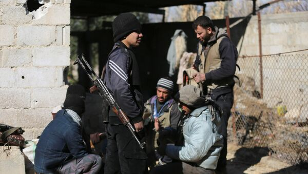 Fighters from the Jaish al-Islam (Islam Army), the foremost rebel group in Damascus province who fiercely oppose both the Syrian regime and the Islamic State group, gather inside a building on the frontline in the town of Bilaliyah, east of the capital Damascus, on February 4, 2017 - Sputnik International