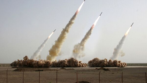 A handout picture released on the news website and public relations arm of Iran's Revolutionary Guards, Sepah News, shows an image apparently digitally altered to show four missiles rising into the air instead of three during a test-firing at an undisclosed location in the Iranian desert (File) - Sputnik International