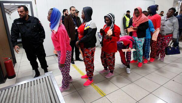 African migrants wait to be deported at Mitiga International Airport, east of Tripoli, Libya, February 14, 2017. - Sputnik International