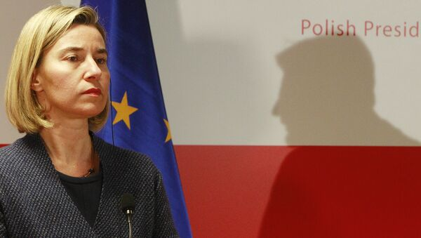 The High Representative of the European Union for Foreign Affairs and Security Policy Federica Mogherini attends a press conference, as the shadow of Poland's Foreign Minister Witold Waszczykowski is seen in the background, after a meeting with foreign ministers of Central and South-Eastern European countries, in Warsaw, Poland, Tuesday, Nov. 29, 2016. - Sputnik International