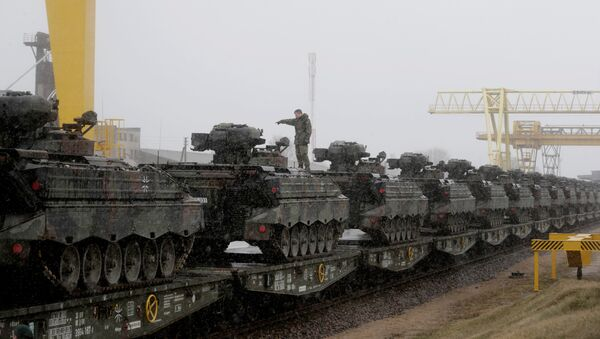 A German army soldier prepares to unload Marder infantry fighting vehicles at the railway station in Sestokai, Lithuania, February 24, 2017 - Sputnik International