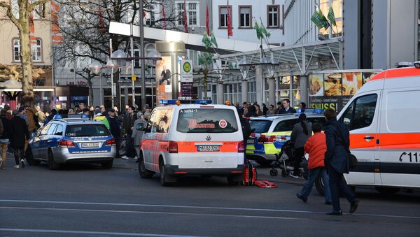 Police vehicle and ambulance stand in front of a business building in Heidelberg, western Germany, where a man ploughed into pedestrians - Sputnik International