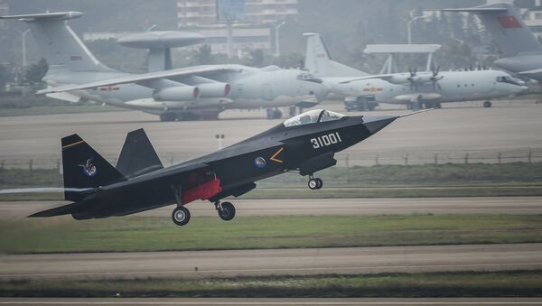 In this photo provided by China's Xinhua News Agency, a J-31 stealth fighter takes off for test flight ahead of the 10th China International Aviation and Aerospace Exhibition in Zhuhai, south China's Guangdong Province, Monday, Nov. 10, 2014. - Sputnik International