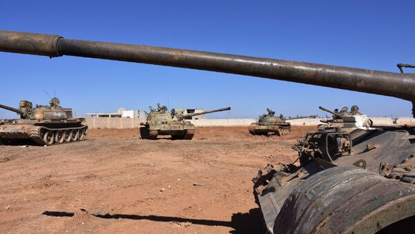 Syrian army tanks are positioned on the eastern outskirts of the northern Syrian city of Aleppo on February 17, 2017 - Sputnik International