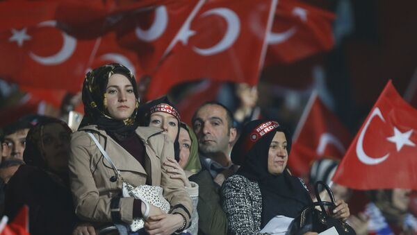 Supporters of the ruling AK Party wave Turkish flags during a campaign meeting for the April 16 constitutional referendum, in Ankara, Turkey, February 25, 2017. - Sputnik International