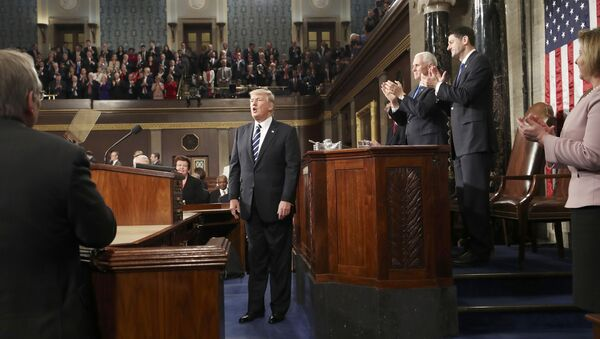 U.S. President Donald Trump is applauded after delivering his first address to a joint session of Congress from the floor of the House of Representatives iin Washington, U.S., February 28, 2017 - Sputnik International