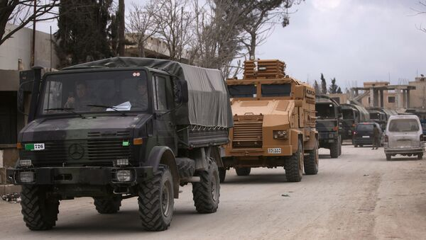 Turkish military vehicles drive in the Syrian rebel-held town of al-Rai, as they head towards the northern Syrian town of al-Bab, Syria March 2, 2017 - Sputnik International