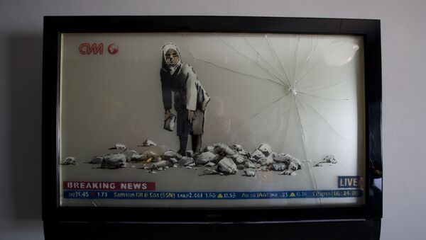 Banksy's work is displayed in the The Walled Off Hotel in the West Bank city of Bethlehem, Friday, March 3, 2017. The owner of a guest house packed with the elusive artist Banksy's work has opened the doors of his West Bank establishments to media, showcasing its unique worst view in the world. The nine-room hotel named The Walled Off Hotel will officially open on March 11. - Sputnik International