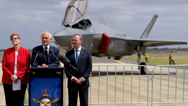 Australian Prime Minister Malcolm Turnbull speaks next to Minister for Defence, Senator Marise Payne and Minister for Defence Industry, Christopher Payne. - Sputnik International