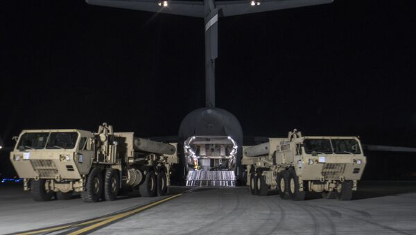 In this photo provided by U.S. Forces Korea, trucks carrying U.S. missile launchers and other equipment needed to set up the Terminal High Altitude Area Defense (THAAD) missile defense system arrive at the Osan air base in Pyeongtaek, South Korea, Monday, March 6, 2017. - Sputnik International