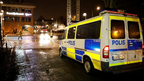 A police car is seen as several cars were set on fire during a riot, according to local media, in Rinkeby suburb, outside Stockholm, Sweden February 20, 2017. - Sputnik International