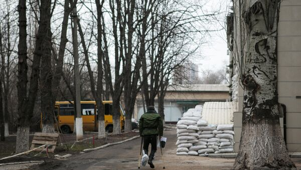 A fighter of the Donetsk People's Republic self-defense force, wounded in action, at the first military hospital in Donetsk - Sputnik International