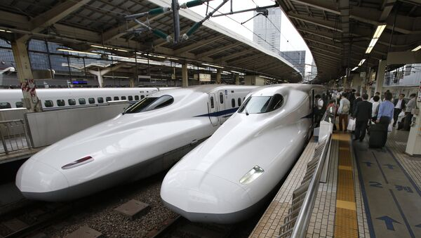 India's Prime Minister Narendra Modi (2nd R) and his Japanese counterpart Shinzo Abe (R) shake hands in front of a shinkansen train during their inspection at a bullet train manufacturing plant in Kobe, Hyogo prefecture on November 12, 2016 - Sputnik International