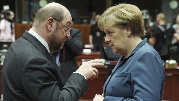 European Parliament President Martin Schulz, left, talks with German Chancellor Angela Merkel, during an EU summit at the European Council building in Brussels (File) - Sputnik International
