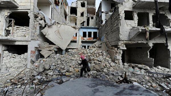 A man walks near damaged buildings in Aleppo, Syria - Sputnik International
