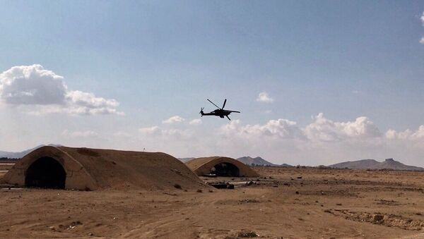 An Mi-28 helicopter flies over the environs of Ancient Palmyra in Homs Governorate, Syria - Sputnik International
