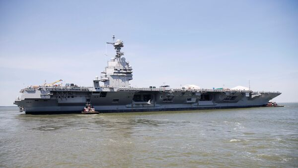 Pre-Commissioning Unit Gerald R. Ford (CVN 78) is maneuvered by tug boats in the James River during the aircraft carrier's turn ship evolution in Newport News, Virginia, U.S. June 11, 2016. - Sputnik International