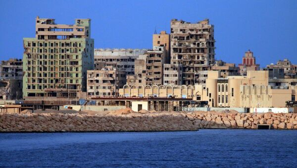 A picture taken on a boat of Libyan naval forces during a patrol shows a view of buildings, including abandoned Omar Khayyam hotel, in the port district in Libya's second city Benghazi on November 20, 2016 - Sputnik International