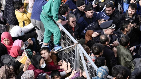 Migrants block the entrance of the Hellinikon camp in Athens in protest at poor living conditions on February 6, 2017 - Sputnik International