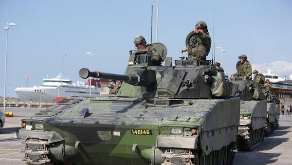 Swedish armoured personnel carriers are seen in Visby harbour, island of Gotland, Sweden September 14, 2016. Picture taken September 14, 2016. - Sputnik International