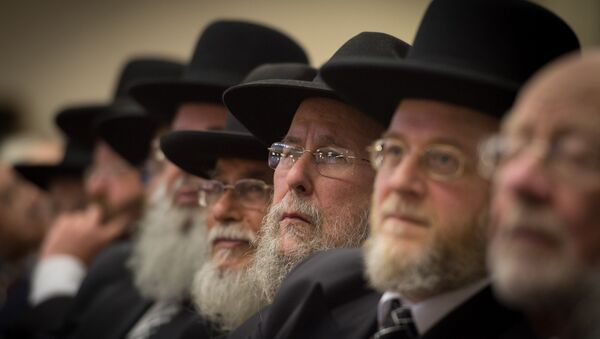 Rabbis and members of the Orthodox Jewish community attend the Installation of Chief Rabbi Ephraim Mirvis as the 11th Chief Rabbi of the United Hebrew Congregations of the UK and the Commonwealth during a ceremony at the St John's Wood Synagogue in north London on Spetember 1, 2013.  - Sputnik International