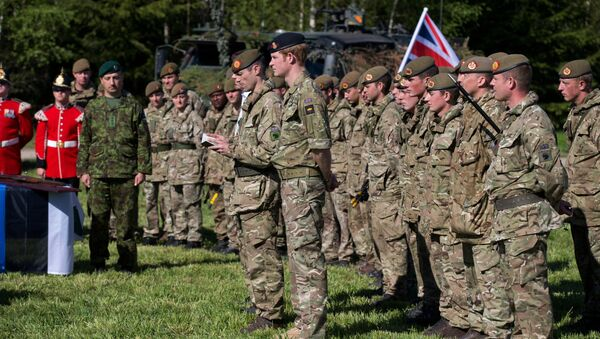 Britain's Prince Harry attends a special ceremony with presentation of the British Certificates of Commendation to Estonian servicemen during NATO's Spring Storm exercise in Otepaa, Estonia, Saturday, May 17, 2014. - Sputnik International