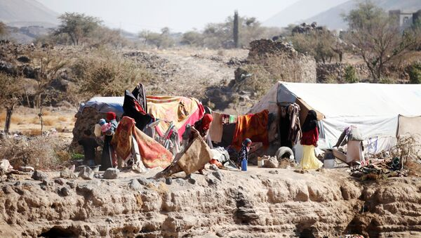 People are pictured near their tent at a camp for internally displaced people in Dharawan, near the capital Sanaa, Yemen, February 28, 2017 - Sputnik International