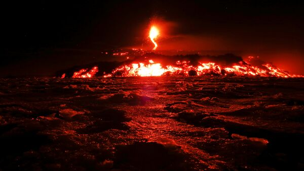 Italy's Mount Etna, Europe's tallest and most active volcano, spews lava as it erupts on the southern island of Sicily, Italy February 28, 2017 - Sputnik International