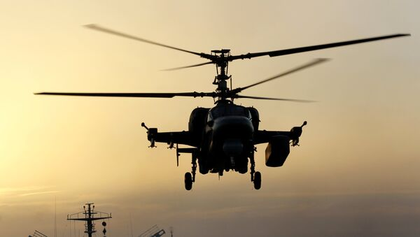 Ka-52K helicopter takes off from the deck of Admiral Kuznetsov heavy aircraft carrier in the Mediterranean Sea - Sputnik International
