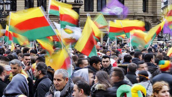 Thousands of Kurds celebrate the Newroz spring festival and protest against Turkish President Erdogan. - Sputnik International