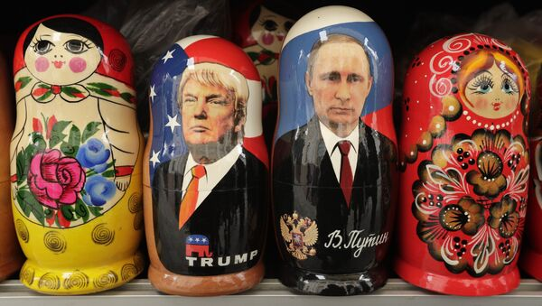 In this Monday, Feb. 20, 2017 traditional Russian wooden dolls called Matryoshka depicting US President Donald Trump, centre left and Russian President Vladimir Putin are displayed for sale at a souvenir street shop in St.Petersburg, Russia - Sputnik International
