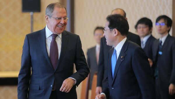 Japanese Foreign Minister Fumio Kishida and Russian Foreign Minister Sergei Lavrov, left, during a meeting held as part of Lavrov's visit to Japan. - Sputnik International