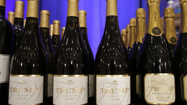 Trump branded wine is displayed prior to a scheduled news conference by Republican presidential candidate Donald Trump, Tuesday, March 8, 2016 - Sputnik International
