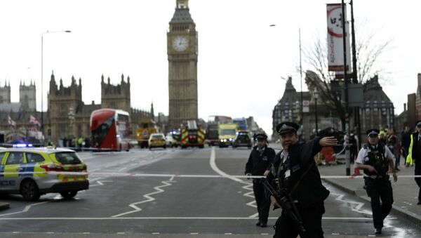 Police secure the area on the south side of Westminster Bridge close to the Houses of Parliament in London - Sputnik International