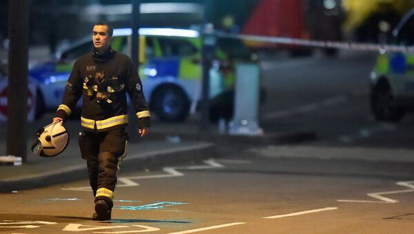 A fire officer works at the scene after an attack on Westminster Bridge in London, Britain, March 22, 2017. - Sputnik International