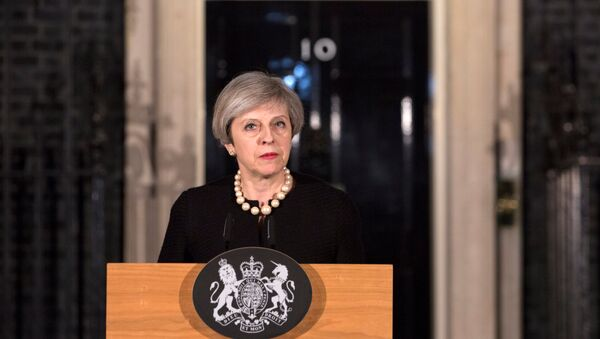 Britain's Prime Minister Theresa May makes a statement at Downing street in London, Britain, March 22, 2017 following the attack in Westminster. - Sputnik International