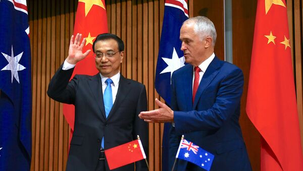 Australia's Prime Minister Malcolm Turnbull gestures to Chinese Premier Li Keqiang at the end of an official signing ceremony at Parliament House in Canberra, Australia, March 24, 2017 - Sputnik International