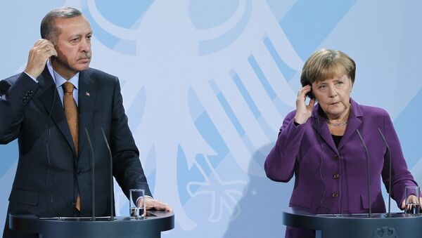German Chancellor Angela Merkel, right, and Turkey's Prime Minister Recep Tayyip Erdogan, left, address the media during a news conference after a meeting at the Chancellery in Berlin, Germany, Wednesday, Nov. 2, 2011. - Sputnik International