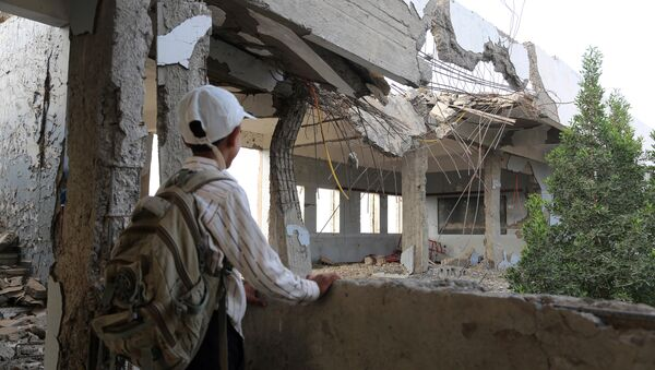 A Yemeni school boy looks at a destroyed school in the Yemeni port city of Hodeidah, on March 15, 2016, which was damaged in the country's ongoing conflict between the Saudi-led Arab coalition fighting Shiite Huthi rebels - Sputnik International