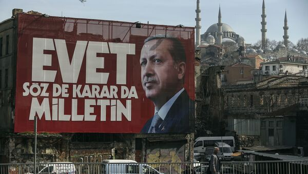 A poster of Turkey's President Recep Tayyip Erdogan for the upcoming referendum is seen backdropped by the Suleymaniye Mosque in Istanbul, Friday, March 24, 2017 - Sputnik International