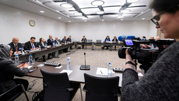 General view of the Syrian government delegation the start of a meeting between UN Special Envoy for Syria and Syria's government delegation during Syria peace talks in Geneva, Switzerland March 25, 2017 - Sputnik International