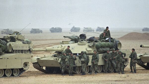 Troops from the Army's 1st Infantry Division lean on an M1A1 Abrams main battle tank as a convoy passes in the background at an assembly point in afternoon on Sunday, Jan. 21, 1991 in Saudi Arabia. Troops from the 1st Infantry Division have taken up positions close to the border with Kuwait - Sputnik International