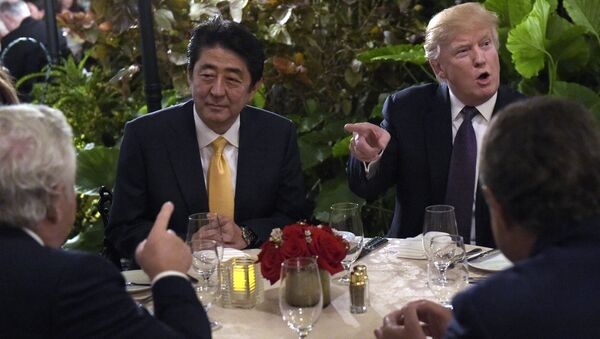 President Donald Trump, second from right, sits down to dinner with Japanese Prime Minister Shinzo Abe, second from left, at Mar-a-Lago in Palm Beach, Fla., Friday, Feb. 10, 2017. Robert Kraft, owner of the New England Patriots, is at left. Trump is hosting Abe and his wife for the weekend. - Sputnik International