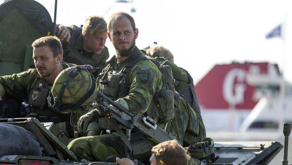 A 160-man combat team from Skaraborg Armoured Regiment deploy in Visby harbour in Sweden on September 14, 2016 - Sputnik International