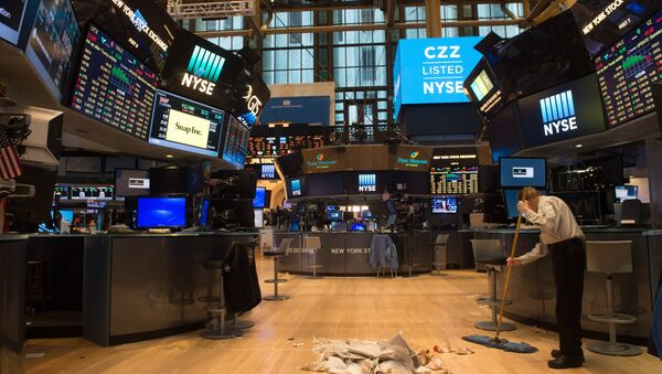 A worker sweeps the floor after the closing bell of the Dow Jones at the New York Stock Exchange, March 24, 2017 in New York - Sputnik International