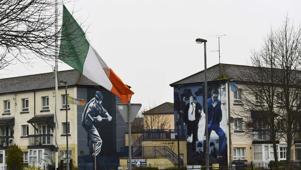 The Irish flag flies at half-mast after the death of Martin McGuinness, in the Bogside area of Londonderry, Northern Ireland, March 21, 2017. - Sputnik International